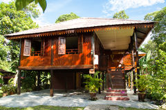 Malay Traditional House. Malay house are traditional dwellings, originating before the arrival of foreign or modern influences, and constructed by the indigenous Royalty Free Stock Image