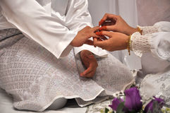 Malay traditional wedding ceremony. Shake hand to accept vow Royalty Free Stock Photos