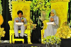 Malay wedding ceremony. Two young muslim couple making a prayer on their wedding day stock image