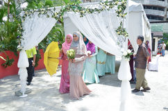 Malay wedding ceremony, Malaysia. Kuala Lumpur, Malaysia – March 22, 2014. Malay Wedding Ceremony. A bride with het bridesmaids walking to meet a groom Royalty Free Stock Photography