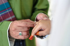 Malay wedding ceremony. Malaysia. Groom putting a diamond ring to his bride's finger Stock Photography