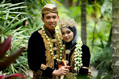 Malay Wedding Couple. The Malay traditional wedding is a very elaborate and cultural event which takes months to prepare and takes place with much fanfare. In royalty free stock image
