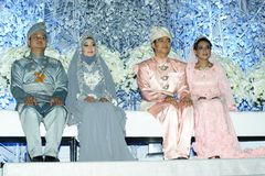 Malay wedding couples in traditional dress at wedd Royalty Free Stock Image
