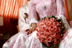 Malay Wedding Flower Bouquet. A malaysian couple newly wedding holding flower bouquet Stock Photography