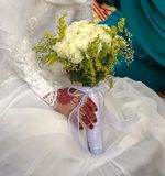 Bride holding bouquet of flower stock image