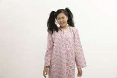 Malay woman. With baju kedah on the white background Royalty Free Stock Photos