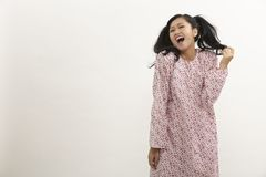 Malay woman. With baju kedah on the white background Stock Photography