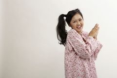Malay woman. With baju kedah on the white background Royalty Free Stock Photo