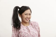 Malay woman. With baju kedah on the white background Stock Image