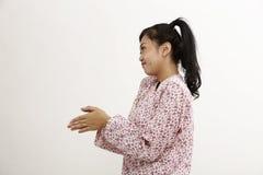 Malay woman. With baju kedah on the white background Stock Photos