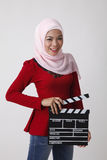 Malay woman holding clapper board Royalty Free Stock Photography