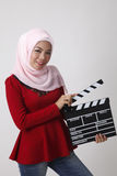 Malay woman holding clapper board Stock Photos