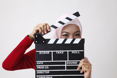 Malay woman holding clapper board Stock Photo