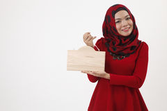 Malay woman holding wooden signage Stock Photo