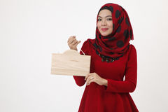 Malay woman holding wooden signage Royalty Free Stock Photo