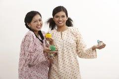 Malay women with pelita Stock Image