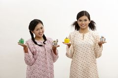 Malay women with pelita Royalty Free Stock Photos