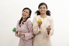 Malay women with pelita Stock Photography