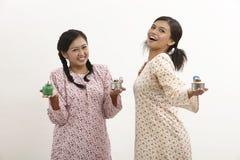 Malay women with pelita Stock Images