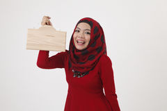 Malay womman holding wooden signage Stock Image