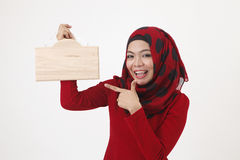 Malay womman holding wooden signage Royalty Free Stock Photo
