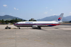 Malaysia Airlines Boeing 737. LANGKAWI, MALAYSIA - FEBRUARY 21, 2014: Malaysia Airlines Boeing 737 on the tarmac at Langkawi Airport. Malaysia Airlines is the Royalty Free Stock Photography