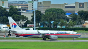 Malaysia Airlines Boeing 737 taxiing at Changi Airport stock images