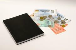 1Malaysia Beleg oder Baucar Buku 1Malaysia (BB1M) des Buch- Stockbild