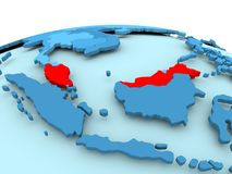 Malaysia on blue political globe. Map of Malaysia in red on blue political globe. 3D illustration Royalty Free Stock Images