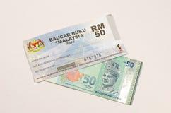 1Malaysia bon ou Baucar Buku 1Malaysia (BB1M) du livre Photos stock