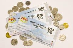 1Malaysia bon ou Baucar Buku 1Malaysia (BB1M) du livre Photographie stock libre de droits