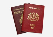 Malaysia and Cambodian Passport Royalty Free Stock Images