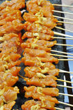 Malaysia Chicken Satay Cooking on a Hot Charcoal Grill Royalty Free Stock Photo