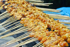 Malaysia Chicken Satay Cooking on a Hot Charcoal Grill Royalty Free Stock Image
