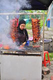 Malaysia chicken wing market. Picture shows a woman sells chicken wings at the Ramadan food market in Malaysia. The chicken wings are grilled and mixed with Royalty Free Stock Images