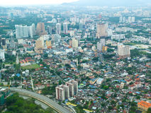 Malaysia city view with bungalows. City view with bungalows and highway in Malaysia Royalty Free Stock Image