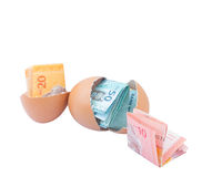 Malaysia Currency and Eggshells I Stock Image