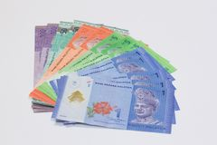 Stack of Ringgit Malaysia bank note with isolated white background royalty free stock photography
