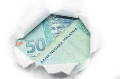 Malaysia currency peeking through white paper Royalty Free Stock Images