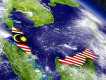 Malaysia with embedded flag on Earth Royalty Free Stock Photo