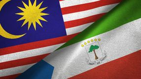 Malaysia and Equatorial Guinea two flags textile cloth, fabric texture. Malaysia and Equatorial Guinea two folded flags together royalty free illustration