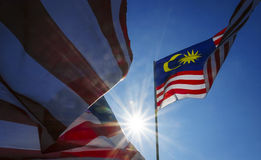 Malaysia Flag. Also known as Jalur Gemilang wave with the blue sky. Every year in August the government of Malaysia urged people to fly the flag in conjunction Royalty Free Stock Images