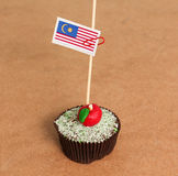 Malaysia flag on a apple cupcake Royalty Free Stock Photography