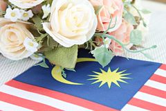 Malaysia flag and flower on tablecloth Stock Photography