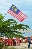 Malaysia flag flying over a restoran on the beach Stock Photos