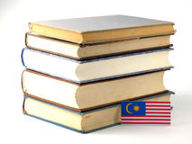 Malaysia flag with pile of books  on white background Stock Images