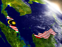 Malaysia with flag in rising sun Royalty Free Stock Images