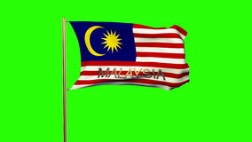 Malaysia flag with title waving in the wind stock footage
