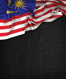 Malaysia Flag Vintage on a Grunge Black Chalkboard With Space Fo Royalty Free Stock Photo