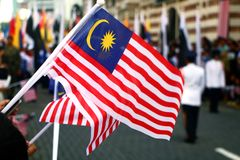 Malaysia flaggor som vinkar under nationell dag Royaltyfri Bild